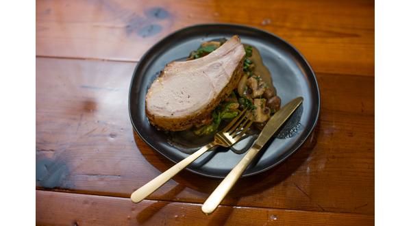 Roasted Bone-in Pork Loin with Mushroom, Garlic, Tomato Ragout + Braised Greens